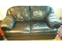 Black leather 2 seater sofa for sale! In clean condition
