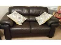 Beautiful 2 seater brown leather sofa