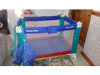 Good condition petite star travel cot
