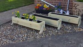 wooden planters , garden flowers , herb / veg garden , plant pots