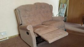 2 seater sofa and matching chair with pop up foot rests