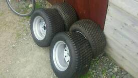 Four top quality ride on lawn mower/tractor wheels and tyres