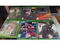 Various xbox one games for sale.
