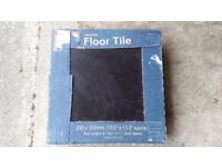 2.5 boxes of black ceramic tiles approx 2.5m2