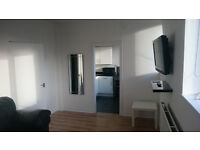 Modern 2 bedroom flat available for rent in prime location.