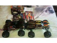 Two traxxas stampedes vxls one 4wd and other 2wd monster trucks with batterys