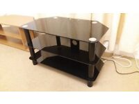 Black Glass TV Unit Table Stand. 3 Tier. Very good condition. Only slight marks to top tier. V nice.