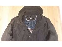 Calvin Klein. Size XL in black. Machine washable. Water resistant shell. Wind protection