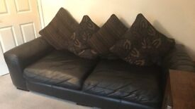 Black leather 4 seater sofas for only £250 each (ONO) *don't miss out*