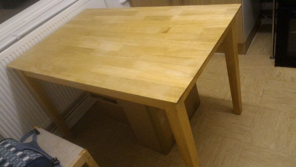 Wooden solid table priced for immediate sale!