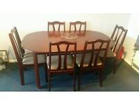 Dining table and 6 chairs. Mahogany in colour