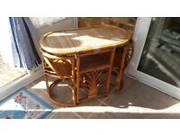 Small cane conservatory table with chairs at end