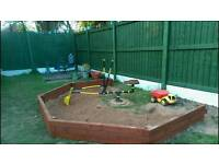 Sandpit with digger