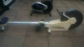 Cross trainer and rowing machine