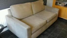 2 seater sofa. Beige suede. Clean and comfortable