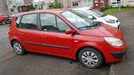 Red Renault Scenic with MOT still 2018