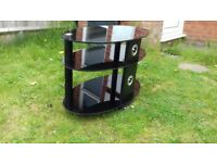 TV TABLE BLACK GLASS, GOOD CONDITION, 3 LAYERS, CURVY!
