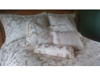 BEAUTIFUL, COMPLETE BED SET..FITS DOUBLE-KING SIZE....QUILT,BED SKIRT,2SHAMS,CUSHIONS AND BOLSTER