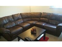 Second hand brown leather recliner corner sofa