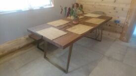 Dining room table and matching bench for sale.