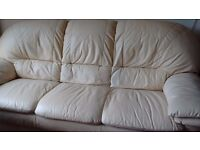 Cream leather sofa,hardly used. Smoke and pet free home.