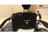 OLYMPUS OM-D E-M5 (Mk1) 16.1 Mirrorless Camera with Battery Grip and spare batteries/charger