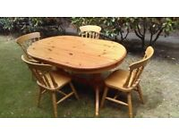 Solid Pine, Twin Pedestal Table and 4 spindle back chairs