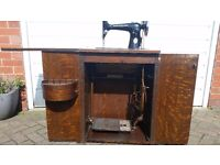 Vintage Singer Treadle Sewing Machine in cabinet