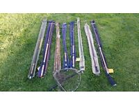 A collection of 8 vintage fly rods and a 'Hardy's' foldable landing net.