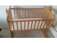 Vintage swinging baby crib