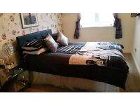 Double bed with black diamonte headboard