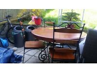 Solid mahogany and cast iron dinning table and chairs £65 PICK UP ONLY