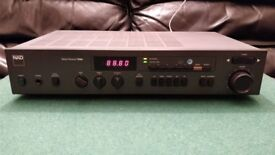 Vintage NAD 7020e (3020-based) HiFi stereo amplifier and tuner/receiver with phono input.
