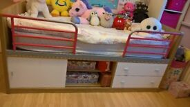 Single bed with drawers and shelf
