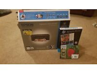 Epson 3in1 wireless printer scanner and fax. with new box of cartridges and paper.