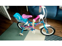 "Girls Pom Pom 12"" bike with dolls seat."