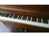 Upright piano complete with stool