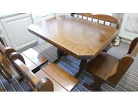 solid wood table with 6 seats in very good condition