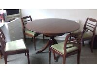 Lovely extendable dark wood dining table and chairs