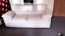 Large 2 seater cream sofa