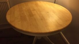White and pale wood dining table