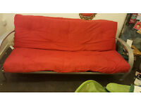 well used but solid futon sofa bed