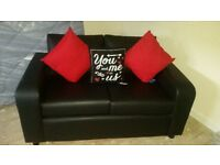 2 seater black leather sofa brand new