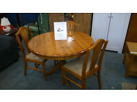 Pine round extending table with 3 chairs