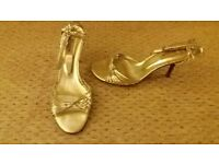 ladies gold strappy high heeled sandals from Dune. Size 4