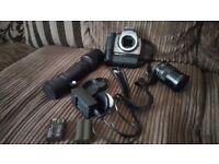 Canon eos 300 camera and 2 lenses