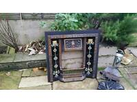 Victorian fireplace with gas fire and coals