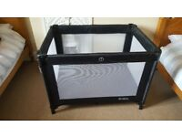 Black redkite travel cot with carry bag in great condition from pet and smoke free home