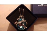 Light blue swavoski crystal serpent pendant necklace in original box beautiful peice worn only once