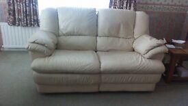 Two seater reclining Italian leather sofa .